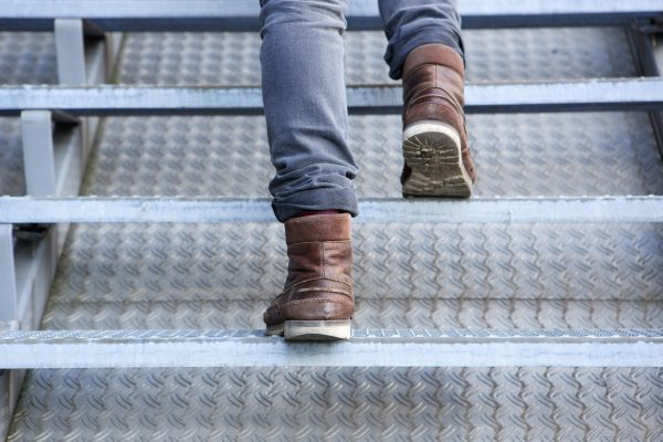 Close up rear view of man walking up stairs in boots Prevent Alzheimer's
