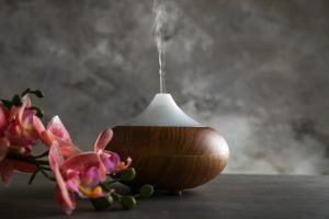 Aroma oil diffuser and orchid on table aromatherapy for depression