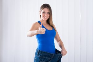 Woman Showing Her Weightloss